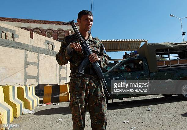 A Yemeni soldier stands guard outside the United States' embassy on February 11 2015 in the capital Sanaa a day after its closure The US has shut its...