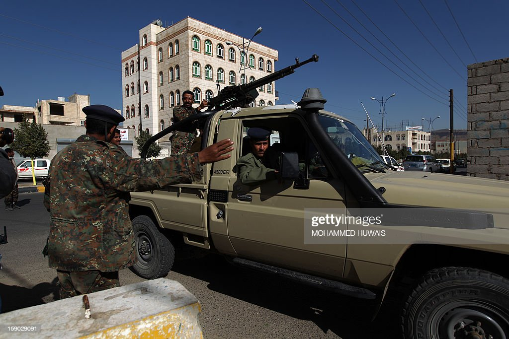 Yemeni soldiers arrive at the state security court in the Yemeni capital Sanaa where the trial of suspected Yemeni al-Qaeda militants takes place on January 6, 2013 .
