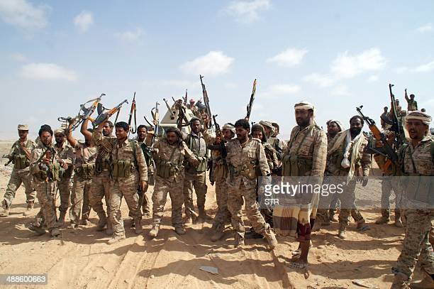 Yemeni soldiers brandish their weapons as they take part in an offensive against extremists in the southern province of Shabwa on May 7 2014 The...