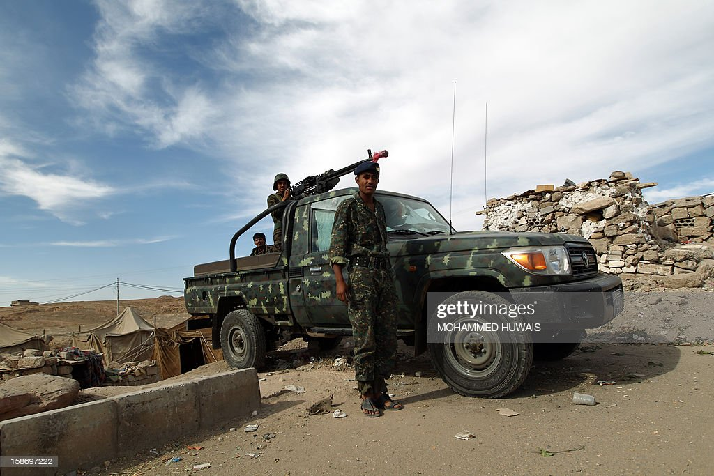Yemeni soldiers man a checkpoint at the entrance to the capital Sanaa, on December 24, 2012, following the kidnapping of three foreigners. Gunmen suspected of links to Al-Qaeda kidnapped two Finns and one Austrian in the Yemeni capital Sanaa on December 21, security officials told.