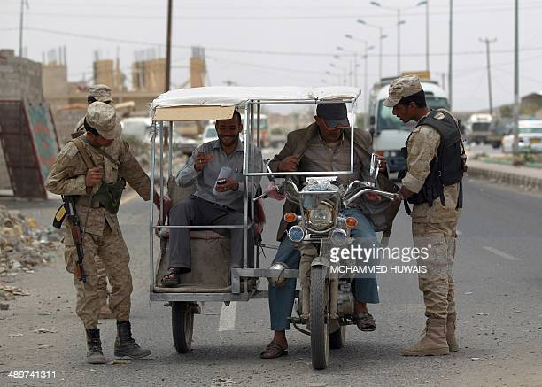 Yemeni soldiers man a checkpoint in the capital Sanaa on May 12 one day after in an attack on a military base by a suspected AlQaeda suicide bomber...