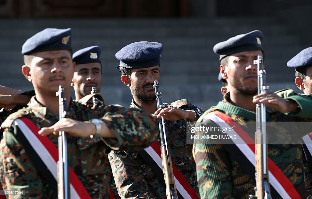 Yemeni soldiers stand guard as they attend a funeral service in Sanaa on November 22, 2012, after that ten of their comrads where killed in a crash of a military plane the previous day. The plane crashed on November 20 as it tried to make an emergency landing when an engine failed, accorading Yemen's defence ministry.