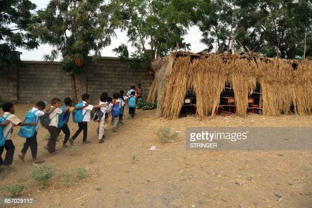 TOPSHOT Yemeni students enter their a makeshift classroom in the Yemeni port city of Hodeidah on March 15 after their school was damaged in the...