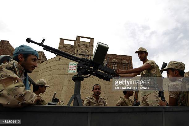 Yemeni supporters of the Shiite Huthi movement ride in the back of a truck during a rally in the capital Sanaa on July 24 protesting against air...