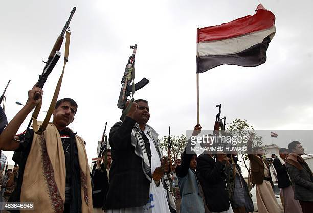 Yemeni supporters of the Shiite Huthi rebel movement raise their weapons during a rally to protest against a military offensive by a Saudiled...
