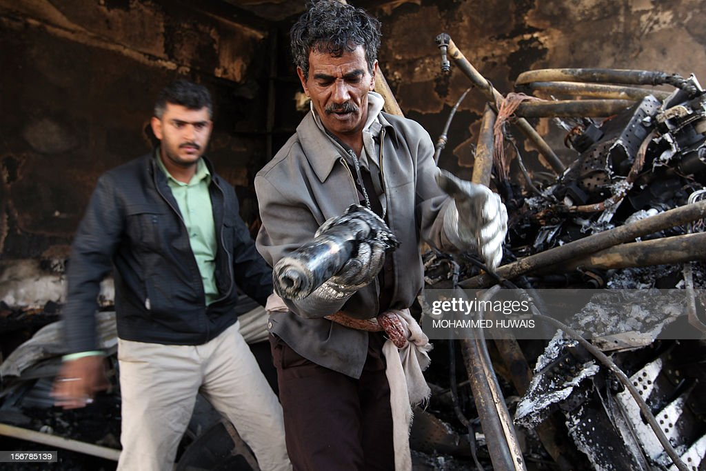 A Yemeni technical investigator inspects parts from the military plane which crashed in Sanaa on November 21, 2012, killing 10 people including the pilot, as it tried to make an emergency landing when an engine failed, according to Yemen's defence ministry and an airport source. The Antonov plane crashed in the Yemeni capital's northern neighbourhood of al-Hassaba while trying to land at an air base near Sanaa's main airport. AFP PHOTO/ MOHAMMED HUWAIS