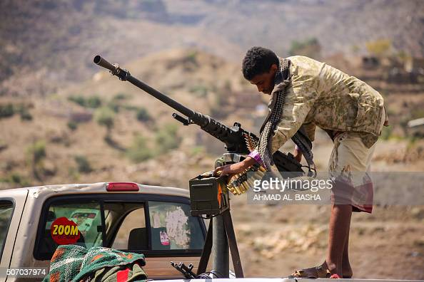 A Yemeni tribesman from the Popular Resistance Committees supporting forces loyal to Yemen's Saudibacked President Abedrabbo Mansour Hadi stand on a...