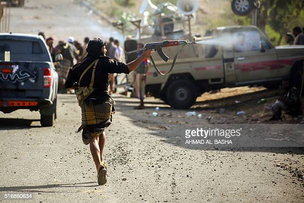 TOPSHOT Yemeni tribesmen from the Popular Resistance Committees supporting forces loyal to Yemen's Saudibacked President Abedrabbo Mansour Hadi hold...