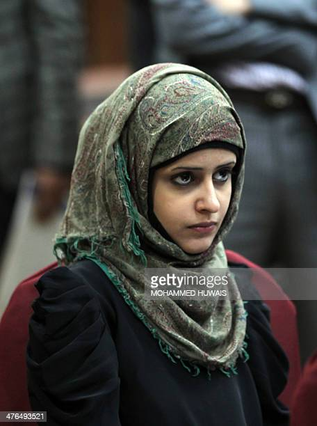 A Yemeni woman attends the showing of a film in Sanaa March 3 2014 about 'child brides' which are quite common in the povertystriken and tribal...