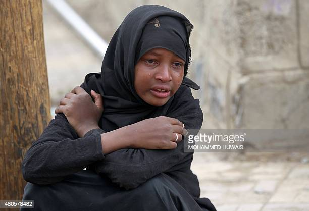A Yemeni woman cries over the death of relatives in a reported airstrike by the Saudiled coalition on the capital Sanaa on July 13 2015 Air strikes...
