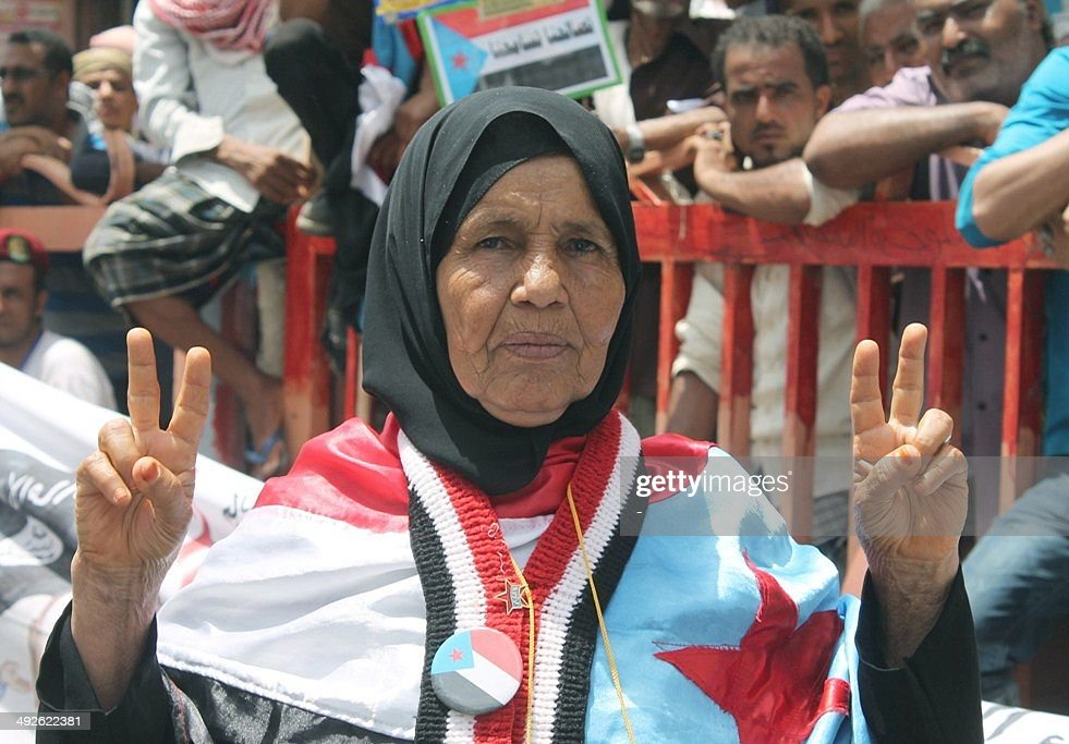 A Yemeni woman draped in the flag of the former South Yemen (The People's Democratic Republic of Yemen), joins thousands as they rally in Yemen's main southern city of Aden, on May 21, 2014, demanding renewed independence for the region on the 20th anniversary of a secession bid that was crushed by northern troops. Southern Yemen united with the North Yemen (Yemen Arab Republic) on May 22, 1990, to form the present-day Yemen. After four years, South Yemen declared its secession from the north, which resulted in the north occupying south Yemen and the 1994 civil war.