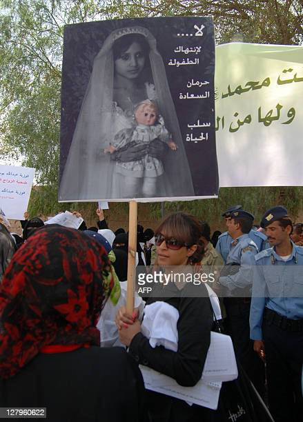 A Yemeni woman hold a picture of a child bride during a rally near the parliament in Sanaa on March 23 2010 to show support to a proposed legislation...