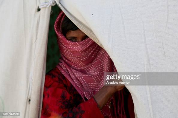 Yemeni woman is seen inside of a tent near the Mocha port on the Red Sea in Taiz Yemen on March 1 2017 Escalating clashes cause internal migration of...