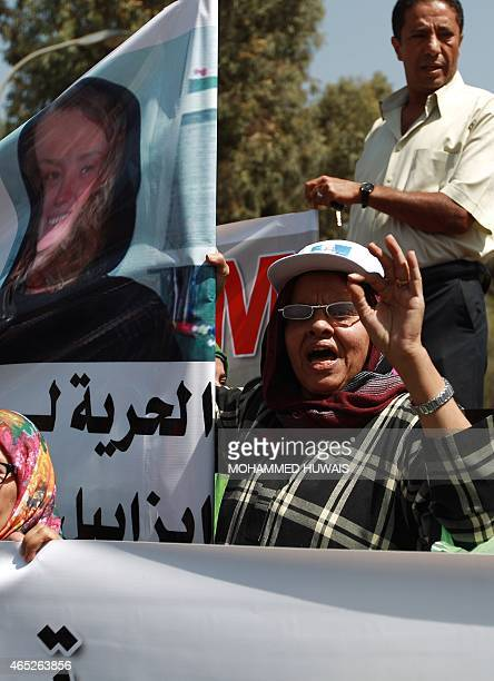 A Yemeni woman shouts slogans during a demonstration in solidarity with two abducted women French Isabelle Prime and her Yemeni interpreter Sherine...