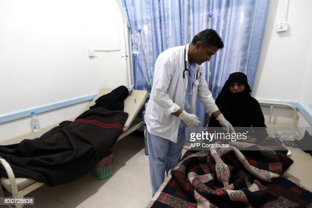 A Yemeni woman suspected of being infected with cholera receives treatment at a hospital in the capital Sanaa on August 12 2017 A cholera outbreak...
