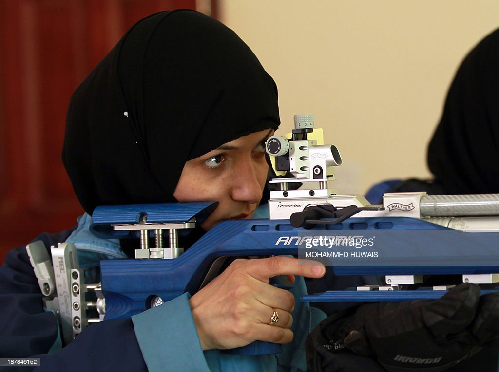 A Yemeni woman trains at a marksmanship club in Sanaa on November 13, 2013 ahead of a local shooting competition this week.