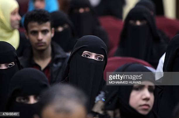 Yemeni women attend the showing of a film in Sanaa March 3 2014 about 'child brides' which are quite common in the povertystriken and tribal country...