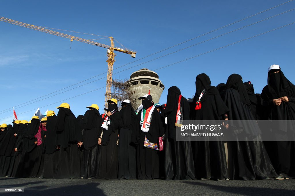 Yemeni women demonstrate in Sanaa on December 20, 2012, in support of President Abdrabuh Mansur Hadi's decision to restructure Yemen's military. Hadi has dramatically restructured Yemen's military to curb the influence of those linked to toppled strongman Abdullah Ali Saleh with the strong backing of Yemen's Gulf neighbours.