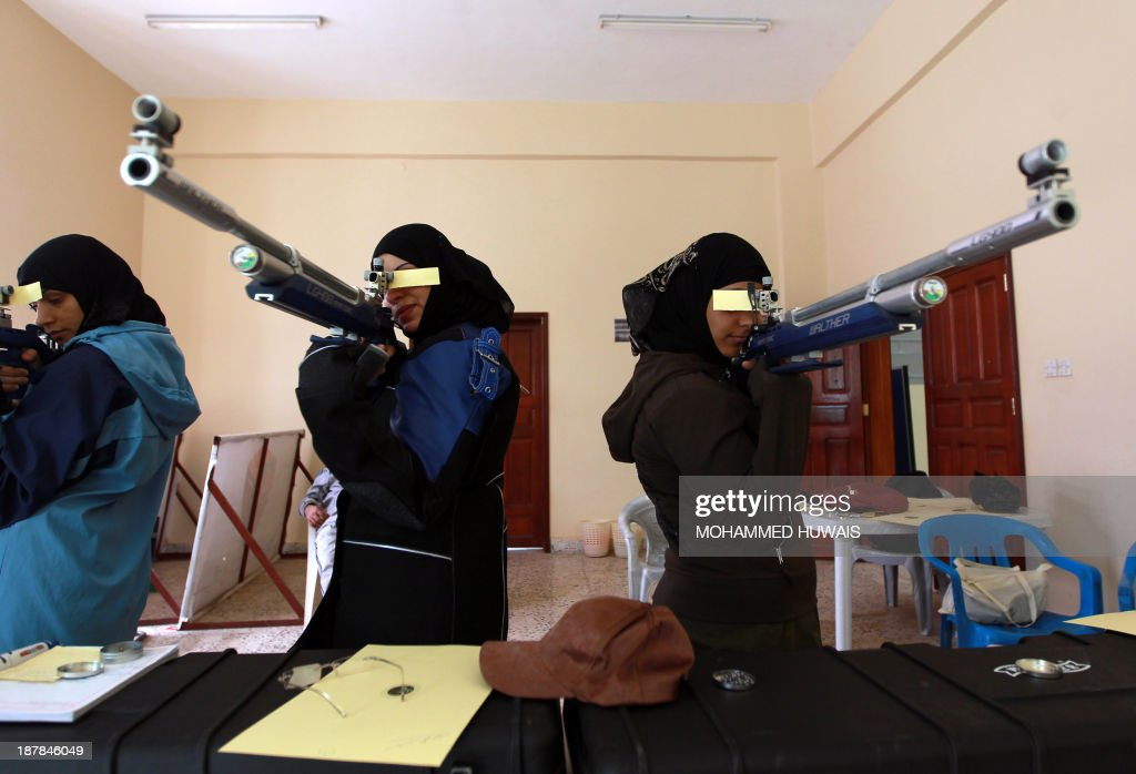 Yemeni women train at a marksmanship club in Sanaa on November 13, 2013 ahead of a local shooting competition this week.