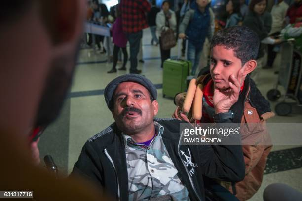 Yemenis Ahmed Abdallah and son Hezam who were among those stranded in Djibouti when President Trump ordered his travel ban arrive to Los Angeles...