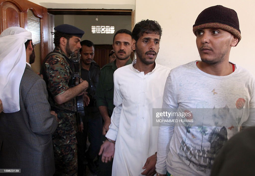 Yemenis allegedly accused of complicity in a suicide bombing that killed 86 soldiers in May 2012, arrive for their trial at a state security court in the capital Sanaa, on January 21, 2013. The nine defendants who are suspected members of the Al-Qaeda cell called Sawane, have notably been accused of 'participation in armed gang, conspiracy to assassinate officials.'