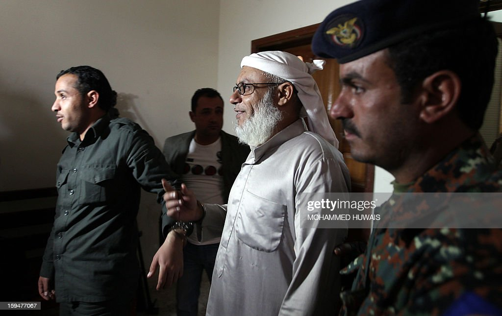 Yemenis allegedly accused of complicity in a suicide bombing that had killed 86 soldiers in May 2012, arrive for their trial at a state security court in Sanaa on January 14, 2013. The nine defendants who belong to an Al-Qaeda terrorist cell called Sawane, have notably been accused of 'participation in armed gang, conspiracy to assassinate officials.' AFP PHOTO/ MOHAMMED HUWAIS
