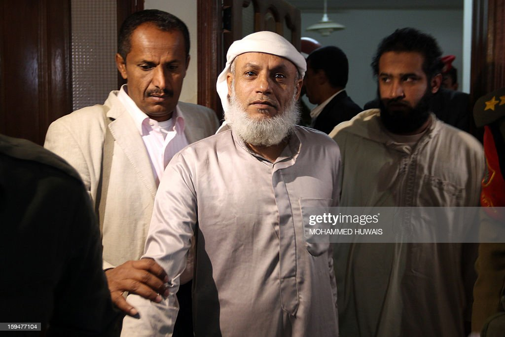Yemenis allegedly accused of complicity in a suicide bombing that had killed 86 soldiers in May 2012, arrive for their trial at a state security court in Sanaa on January 14, 2013. The nine defendants who belong to an Al-Qaeda terrorist cell called Sawane, have notably been accused of 'participation in armed gang, conspiracy to assassinate officials.'
