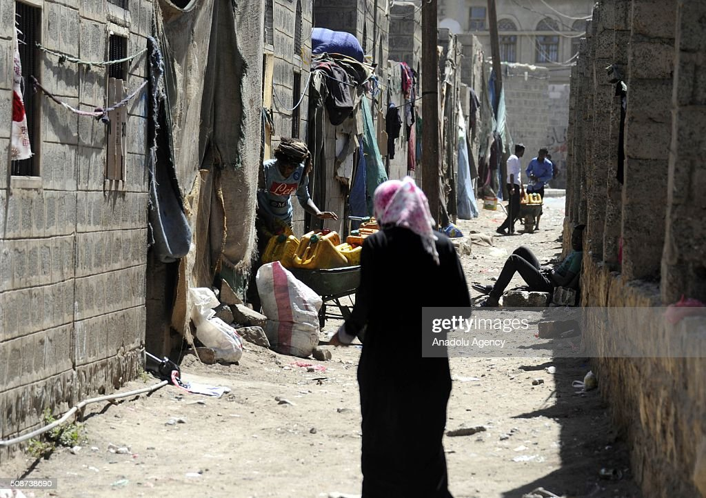 Yemenis are seen on a narrow road in Savan neighborhood as Saudi-led airstrikes continue in Sana'a, Yemen on February 6, 2016.