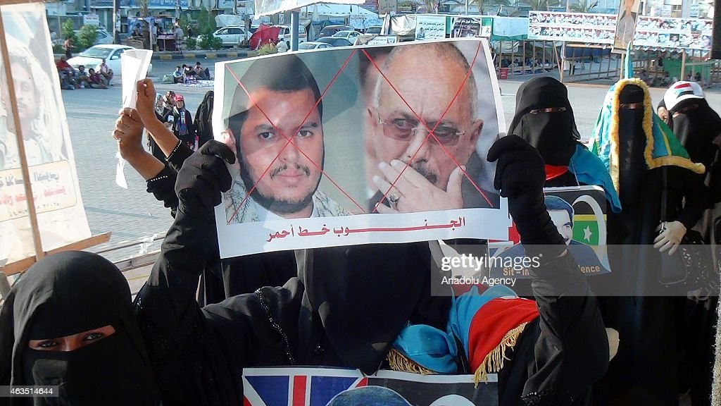 Yemenis burn the posters of Yemeni president <a gi-track='captionPersonalityLinkClicked' href=/galleries/search?phrase=Ali+Abdullah+Saleh&family=editorial&specificpeople=221711 ng-click='$event.stopPropagation()'>Ali Abdullah Saleh</a> and leader of Houthis, <a gi-track='captionPersonalityLinkClicked' href=/galleries/search?phrase=Abdul-Malik+al-Houthi&family=editorial&specificpeople=12337554 ng-click='$event.stopPropagation()'>Abdul-Malik al-Houthi</a> during a rally against the occupation of the cities by Shiite Houthi rebels at Hormaksar square on February 15, 2015 in Aden, Yemen.
