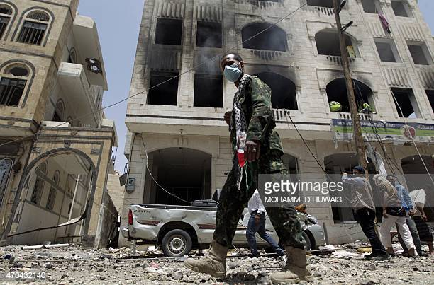 Yemenis check the damage following a raid by Saudiled coalition warplanes on a missile depot on Fajj Attan hill in the rebelheld part of the Yemeni...