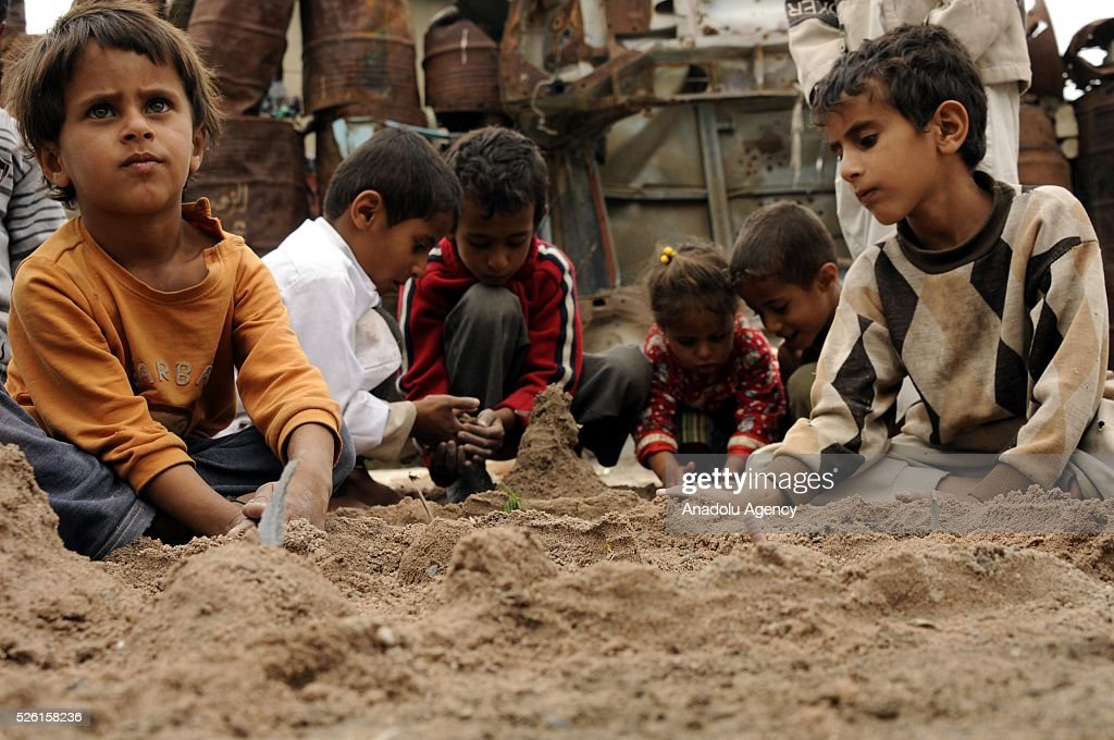 Yemenis children play with sand in the Shwaob neighborhood as the political crisis in the country continues in Sanaa, Yemen on April 29, 2016.