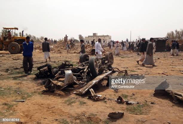 Yemenis gather at the site of a Saudiled air strike on the outskirts of the northwestern city of Saada on August 4 2017 / AFP PHOTO / STRINGER