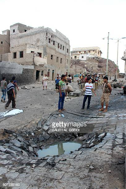 Yemenis gather at the site of a suicide car bombing outside Yemen's presidential palace in the city of Aden on January 28 2016 Islamic State jihadist...