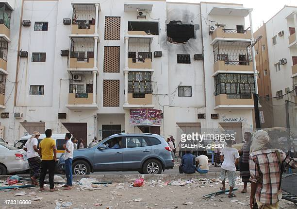 Yemenis inspect a destroyed building in Aden's suburbs on June 24 2015 after rebel forces and loyalist fighters were locked in fierce fighting...