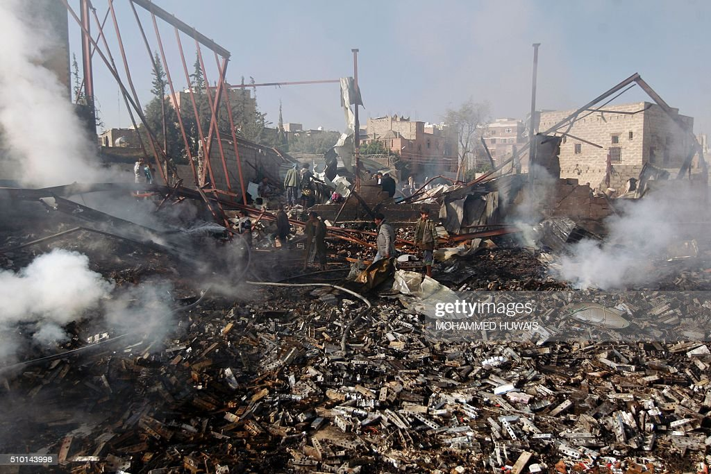 Yemenis inspect the damage at a sewing workshop that was hit by a Saudi-led coalition air strike in the capital Sanaa, on February 14, 2016. The factory owner, Faisal al-Musaabi, told AFP that two employees, including a 14-year-old boy, were killed and 15 others wounded in the overnight air raid. HUWAIS