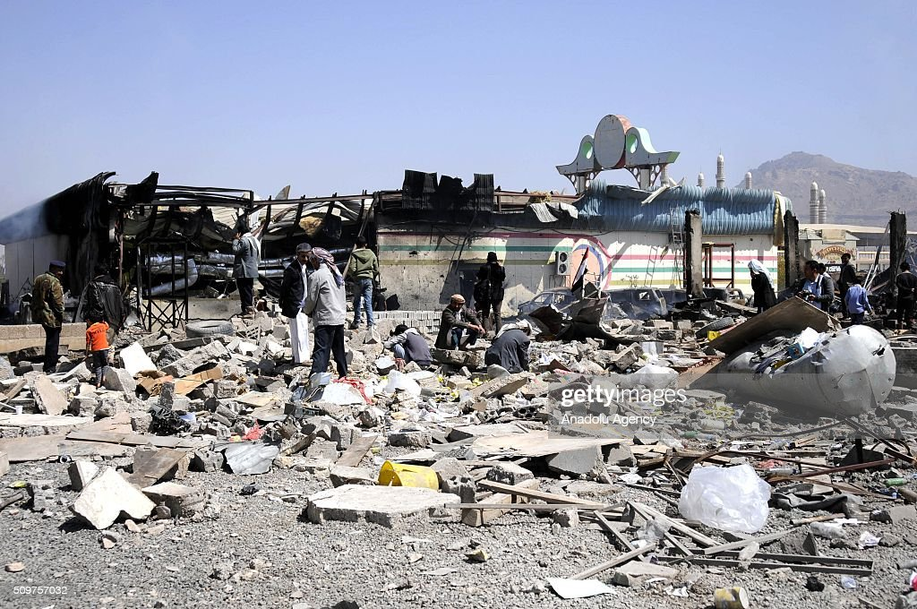 Yemenis inspect the debris a collapsed building after Saudi-led coalition airstrikes hit a bowling saloon at Musbahi district in Sanaa, Yemen on February 12, 2016.