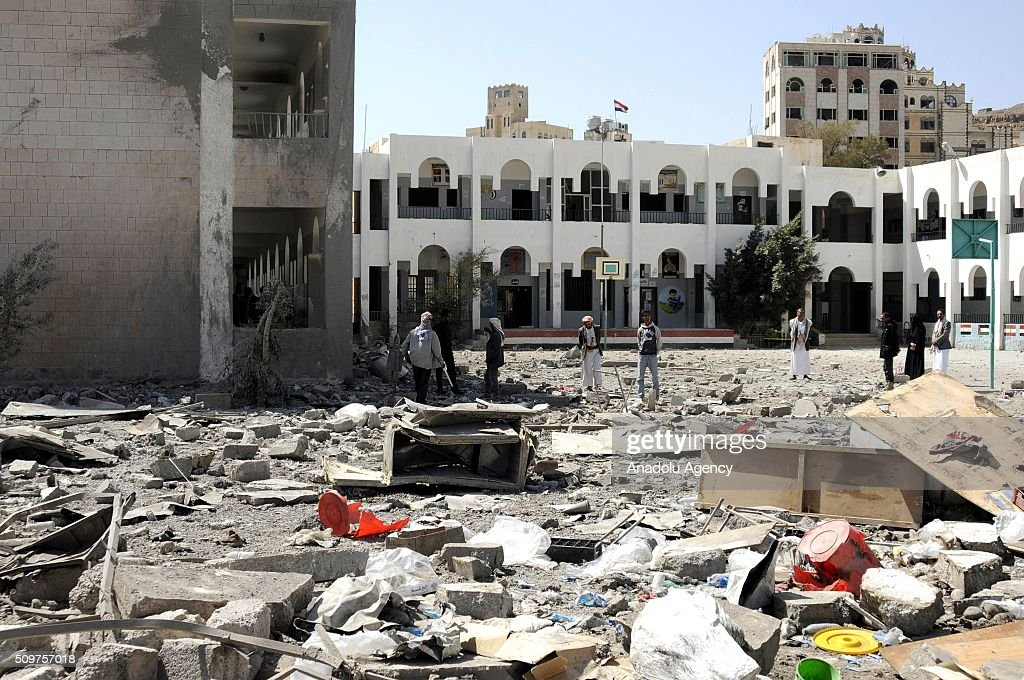 Yemenis inspect the debris of a collapsed building after Saudi-led coalition airstrikes hit a bowling saloon at Musbahi district in Sanaa, Yemen on February 12, 2016.