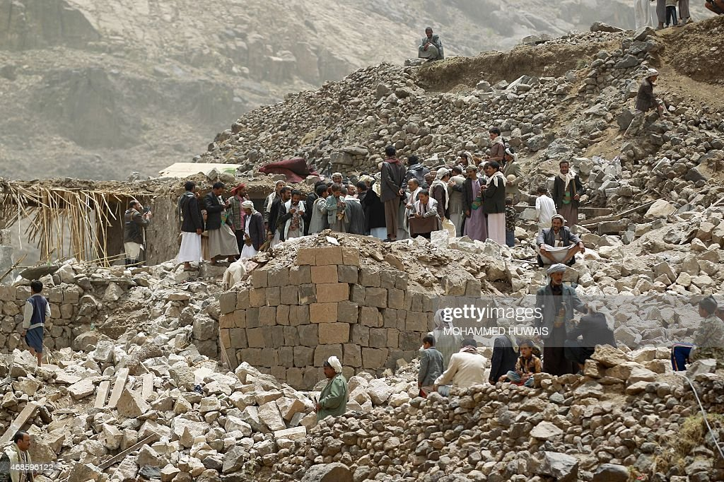 Yemenis inspect the rubble of destroyed houses in the village of Bani Matar 70 kilometers West of Sanaa on April 4 a day after it was reportedly hit...