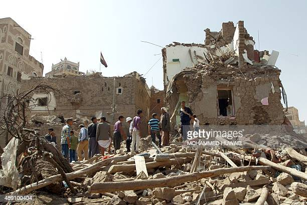 Yemenis inspect the rubble of UNESCOlisted buildings that were destroyed by air strikes carried out by the Saudiled coalition in the AlFalihi...