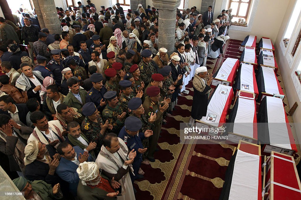 Yemenis pray over the coffins of ten people who were killed in a crash of a military plane the previous day, during a funeral service in Sanaa on November 22, 2012. The plane crashed on November 20 as it tried to make an emergency landing when an engine failed, accorading Yemen's defence ministry.