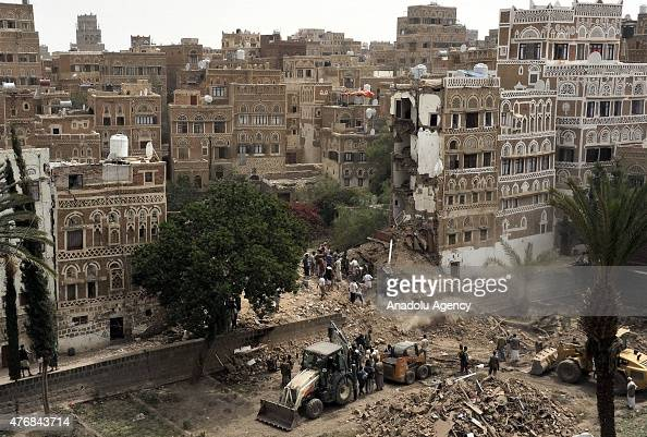 Yemenis search for the air attack victims around the destroyed buildings after Saudiled airstrikes hit Sanaa's Old City Yemen on June 04 2015