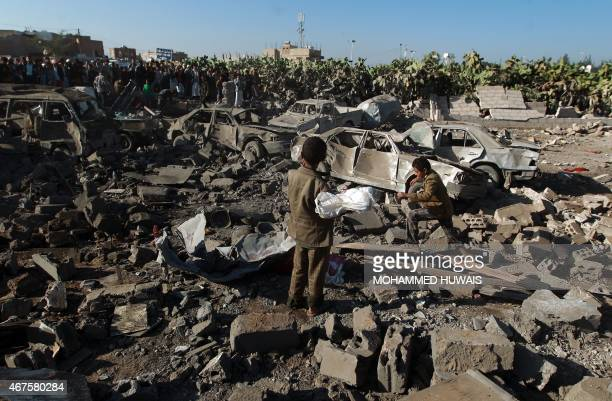 Yemenis stand at the site of a Saudi air strike against Huthi rebels near Sanaa Airport on March 26 which killed at least 13 civilians Saudi...
