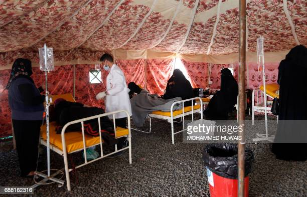 Yemenis suspected of being infected with cholera receive treatment at a makeshift hospital in Sanaa on May 25 2017 Cholera has killed 315 people in...