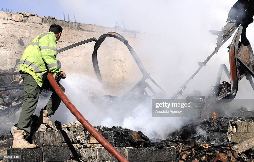 Yemenis try to extinguish fire after the war crafts belonging to the Saudi-led coalition carried out airstrikes at Beit al-Miad district of Sanaa, Yemen on February 10, 2016.