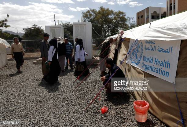Yemenis wait outside a tent where patients infected with cholera are receiving treatment at Sabaeen Hospital in Sanaa on June 13 2017 Six weeks into...