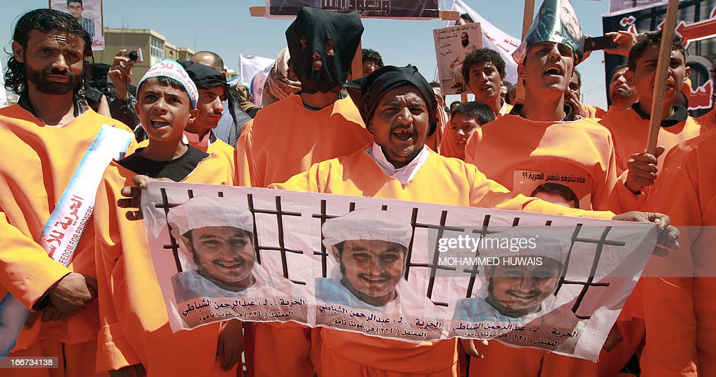 Yemenis wearing orange jumpsuits, similar to those worn by prisoners at the US detention centre in Guantanamo Bay, hold a protest demanding the release of inmates on hunger strike, on April 16, 2013 outside the US embassy in Sanaa. Attorneys representing inmates at the prison have said most of the estimated 130 detainees at Guantanamo's Camp Six wing, which houses 'low-value' prisoners, were on hunger strike.