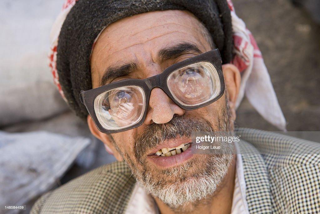 Yemenite man with thick glasses.