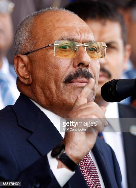 Yemen's expresident Ali Abdullah Saleh gives a speech addressing his supporters during a rally as his political party the General People's Congress...