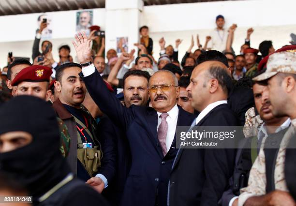 Yemen's expresident Ali Abdullah Saleh waves after giving a speech addressing his supporters during a rally as his General People's Congress party...