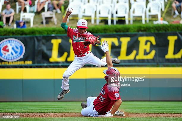 Yen Cheng Yu of the AsiaPacific team from Chinese Taipei slides into second base against Andres Villa of the Mexico team in Lamade Stadium during...